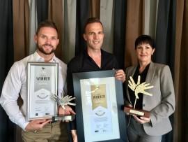 CELEBRATING SUCCESS: Maruis Botes, Reuben Louw and Lara Nolan (co-owners of Thaba Eco Hotel).