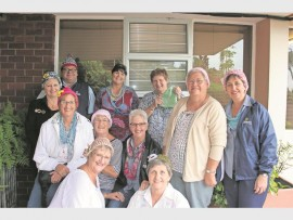 Out-of-town campers and AKTV Natalia staff members with the colourful beanies they knitted and donated to Mooi Hawens.