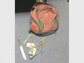 The backpack containing a knife, screwdrivers, customised wheel spanner and an assortment of SIM cards.