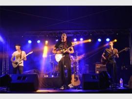 Greg van Vuuren, Sheldon De St Pern and Barry De Beer, (hidden is drummer Ryan De Beer) of  The Remedy Project rock the Kuswag Karnaval at the weekend. PHOTO: Linda Hide
