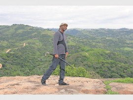 InKhosi Maphumulo with the 'staff of power' on top of Tshehlophe (White Rock).