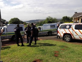 Police and paramedics attend the scene of the attempted hijacking.