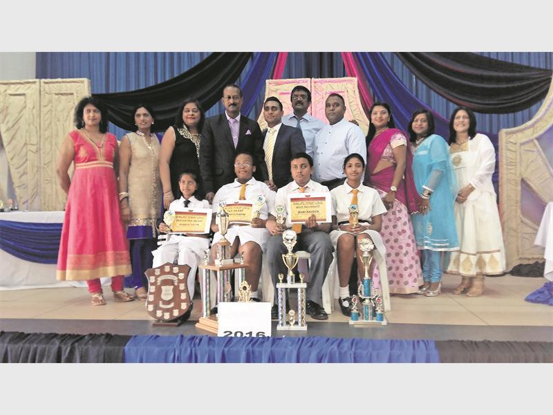 Award committee members and school staff congratulate (front) Khadija Thayab (junior dux award), Lwandile Dlamini (dux award), Joash Mahipath (good fellowship award) and Janisha Parsotam (dux runner-up).