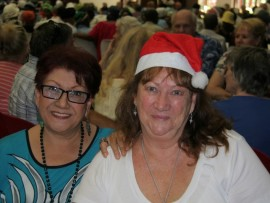 Coral Mey and Maureen Steenkamp bring some festive cheer to the seniors Christmas lunch at Amanzimtoti Civic Centre on Monday, 19 December.