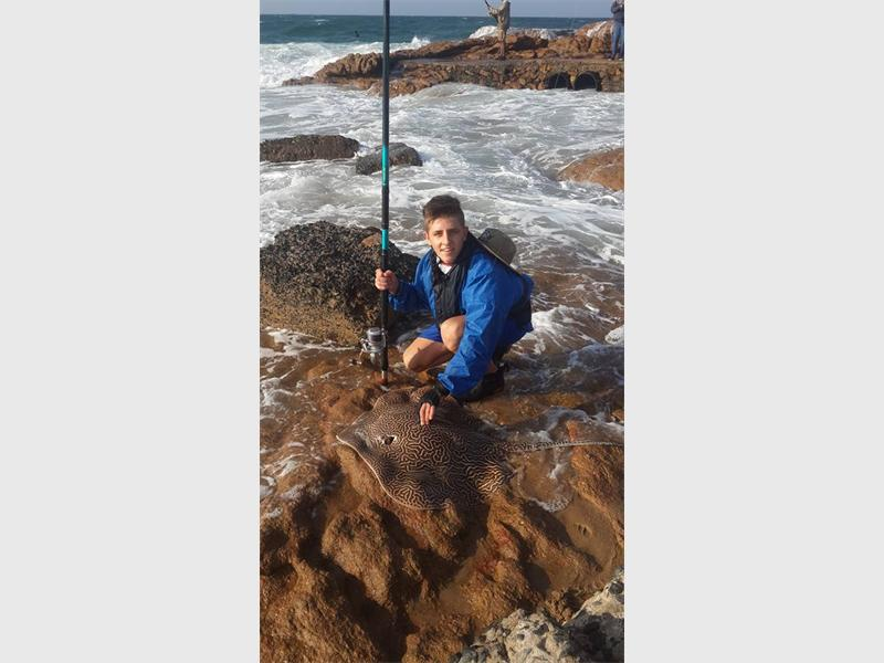 Thomas Konig (18), with a Honeycomb ray he landed.