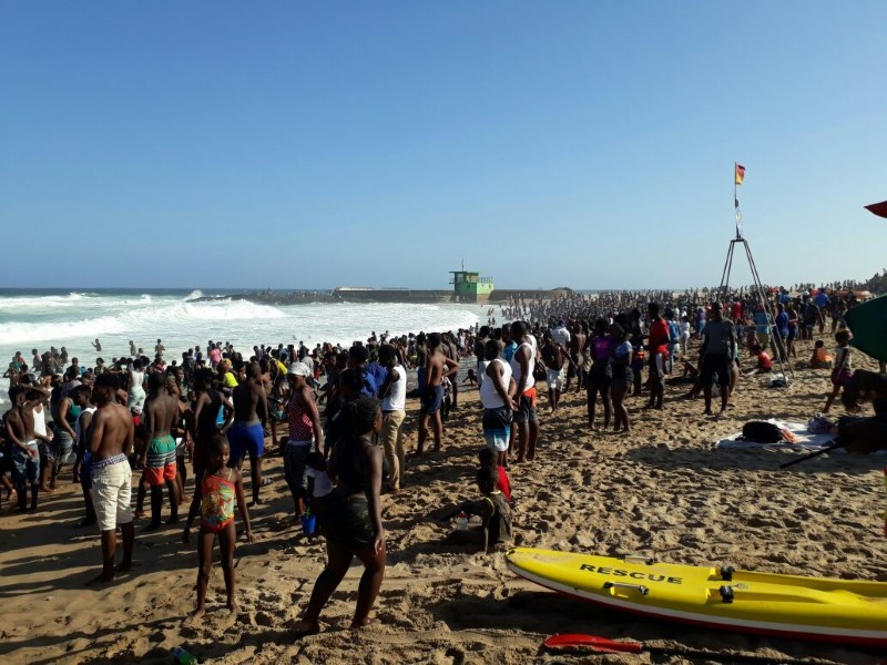 Crowds descend on Toti main beach in December to enjoy the good weather and cool surf.