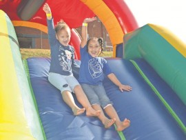 Best Friends: Chaylyn Hartse and Cara King scream for joy as they slide down the castle at the 60th funday celebrations at Dirkie Uys school.