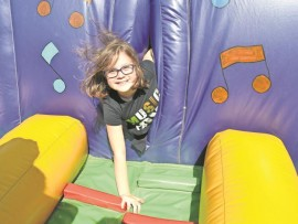Ulinda Boeta squeezes out of a tight spot at the 60th funday celebrations at Dirkie Uys school.