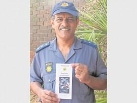 Brighton Beach SAPS relief commander, Captain Desmond Gokul with the brochure.