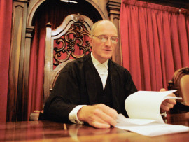 May 2002, Bloemfontein, South Africa --- Judge Edwin Cameron an openly HIV-Positive judge in South Africa's Court of Appeal reading a document in Bloemfontein. --- Image by © Gideon Mendel/Corbis