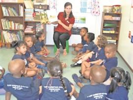 : Bluff Christian Academy preschool pupils listen intensively as their teacher, Mrs Venter reads them a story.