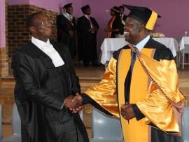 Judge president Dunston Mlambo with Dr Derrick Ndlovu of Umjindi Municipality.