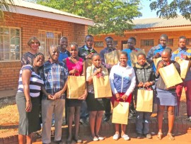 Here are (front) ANC Ward 1 Councillor Sindisiwe Irene Gama, Loueiville Combined School principal Vusimuzi Thwala, Nomcebo Maluleka, Nomfundo Gama, Pretty Mahlalela, Zodwa Zulu and Phetheni Mahava and (back) Elsie Eksteen, Raymond Nkosi, Thulani Mahlalela, Othaniel Magagula, Melusi Siwela, Ronie Nkosi and Siyabonga Motha.