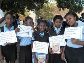 Shariffa Mulla, Mapule Mabuyane, Lindokuhle Fulane, Happiness Sifundza and Nompumelelo Ntiwane head out with their posters.