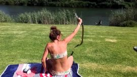 Fearless woman grabs Cobra with bare hands