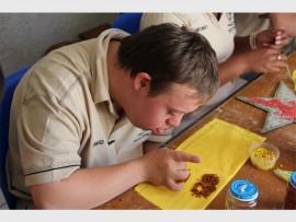 David Tanner busy doing beadwork.