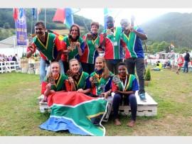 The medalists from the world championships: Sonet Vermaak, Jané Vermaak, Anja Cronjé, Nosipho Themba, (back) Sanjay Singh, Sonja Vermaak, Sherry Goodwin, Joseph Mashaka and Surprise Mdluli.