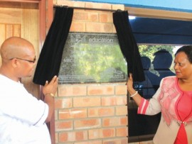 Mr Fana Nkambinde and Ms Reginah Mhaule officially unveil the library at Sintile Secondary School in Kanyamazane