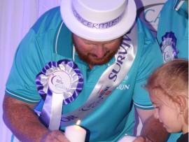 A precious moment between International Hero of Hope, Shaun Terblanche, his wife, Gerdi and daughter, Adeline.