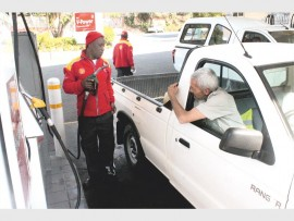 Mr Esau Nkosi helps Mr Jaco Engelbrecht at the Dos Santos Shell.