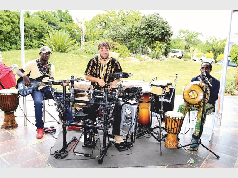 Minanzi Mbira Band's Tendayi Kusaya, Justin Behrendt and Danmore Kusaya. Photo: Elma Slabbert / Elma Photography