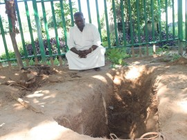 Mr Malama Majeed, Islamic  leader in Mbombela, at one of the opened graves.