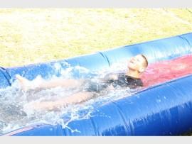 Jason van Wyngaard having fun on a water slide.