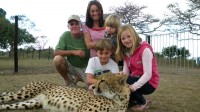 Me, with my wife Sharon, and my grandkids, Denham, Gabriella, and Indie, at Emdoneni Cheetah Rehabilitation Project near Hluhluwe.