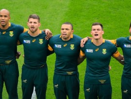 The Springboks sing the national anthem before the game against Wales in the 2015 RWC quarter-finals at Twickenham Stadium. - Image by © Michael Lee - Taiwan Mike/KLC fotos/Corbis