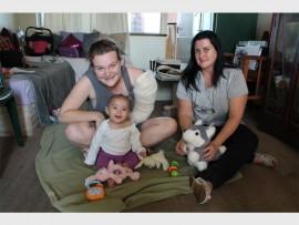 Glenwood mum, Stephanie Meyer seen with her baby Amelia, and community activist Heather Rorick.