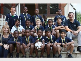 The soccer team with coaches (back) Alistair Whillier and (right) Stefan Mack, and HOD of the prep school, Greta Peens.