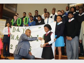 Education MEC, Mthandeni Dlungwane lights a candle to commemorate the 100 day countdown to the 2016 matric NSC exam.