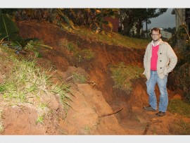 Ward councillor Martin Meyer inspects the damage as a wall in Westgate Gardens collapsed on Monday evening.