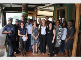 Metro and SAPS officers along with business owners and Heather Rorick from Bulwer Community Safety Forum.