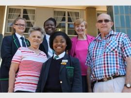 Cate d'Offay, captain of the drummies at Durban Girls' High School, Tebatso Ramotsamai, secretary of the school choir, and Thando Hlongwane, choir leader, with Margaret Doble, Shirley Ralph, and John Horne.