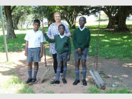 Heather Miller and pupils, Kyle Maistry, Bayanda Nyide and Tapiwa Nhau, show the broken swings and the smashed glass bottles in the park.