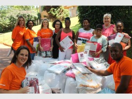 The mountain of new bedding for girls at Wylie House. There to spread the joy on the day were (front) Jayne Frew, Eugene Tenza, (back) Lauren van Niekerk, Christina Murugan, Coral van den Berg, Liandra van Staden, Dinosha Bhailall and Debbie Atkinson, with Nonkululeka Mashiyane, Nazli Finch and Delisile Madlala from Wylie House.