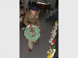 Capt John Johnston-Webber lays a wreath during the ceremony.