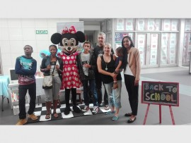 Marketing manager of Davenport Square, Adeela Haffejee (right), with the winning teams, Roxanne Schaik, Mark Strydom, and SP Mange, and children, Kuyolo Mpange, Matthew Strydom and Taylor Van Schaik.
