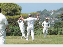 Muhammed Patel successfully takes a catch in the deep Harlequins outfield, celebrated by Ryan Baronet and Trevor Campbell, during a 50 stream one Challenge League match verses Simplex Reservoir Hills.