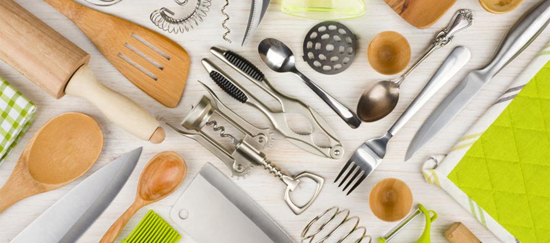 42311391 - background of kitchen utensils on wooden kitchen table