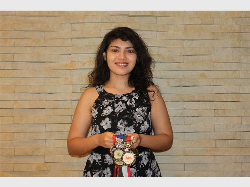 Mishka Ramlagana with some of her academic accolades