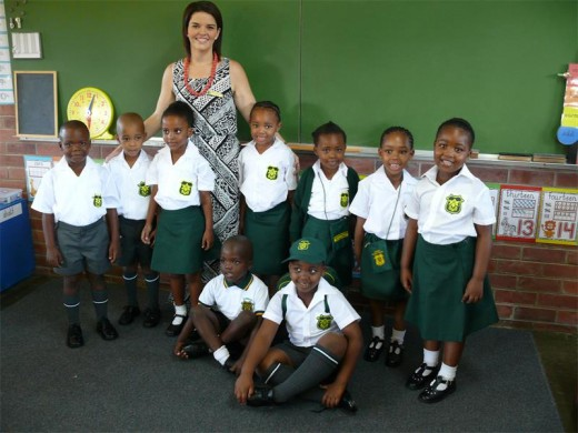 Grade One teacher at Durban Primary School, Miss Angela Wellbeloved with some of her learners.