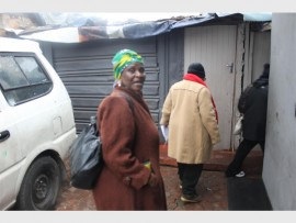 ANC activists walk through alleys canvassing for votes.