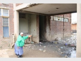 Helen Joseph hostel resident Egnes Matsimula points at sewage blocking entry into a kitchen and rooms.