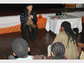 Retired Constitutional Court Judge Albie Sachs engages pupils in commemoration of the June 16, 1976 student uprising.