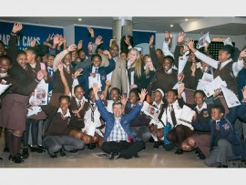 PRIMESTARS managing director, Martin Sweet (seated front) with the pupils from Minerva Secondary school.