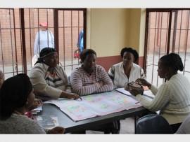 Participants share experiences at a workshop for crèche operators.