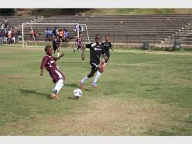 IPHUTHENG'S star player Ngwato Segobela (maroon) controls the ball as Ithute's Simangaliso Mlambo advances.