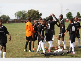 It was celebration time for Skeen Primary School team when the referee blew the final whistle. They are joined by a schoolmate sprawled on the ground with joy.